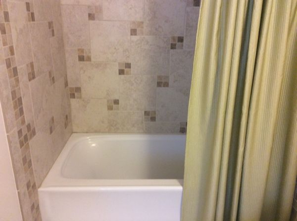 Bath Tub, with tile surround and curtain