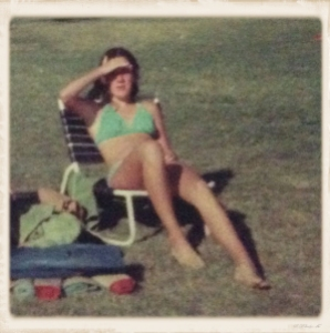 13 year-old me sunbathing in Kauai