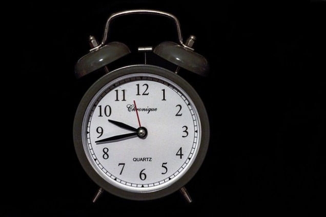 Black and white image of traditional alarm clock