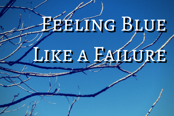 Feeling Blue Like a Failure against blue sky and bare branches