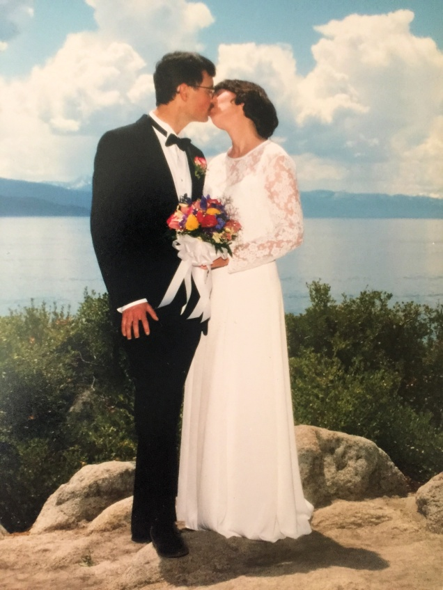 My husband & I kissing on our wedding day in front of Lake Tahoe