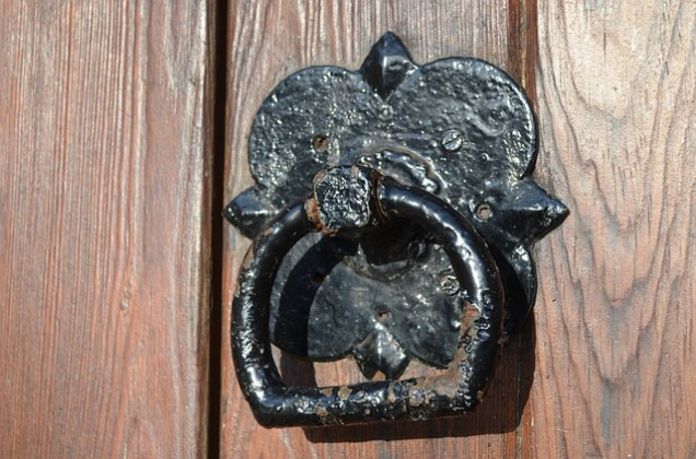 Old Door Knocker on Wood Door
