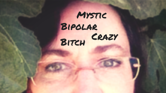Mystic Bipolar Crazy Bitch in permanent marker font on forehead of selfie showing eyes & forehead